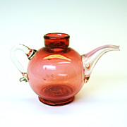 Rare cranberry glass tea pot formed baby feeder bottle