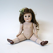 Fine quality antique German jointed all bisque doll with sleep eyes