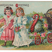 Thanksgiving Postcard with Two Young Girls and a Gobbler in a Wagon