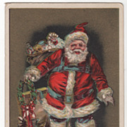 Christmas Santa Claus with Sleigh and Bag of Toys Vintage Postcard