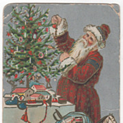 Christmas &quot;A Merry Christmas&quot; Santa Claus Trimming a Tree Vintage Postcard