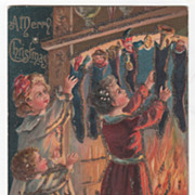 """A Merry Christmas"" Children Opening Stockings Christmas Vintage Postcard"