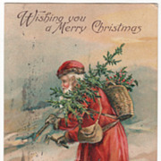 """Wishing You a Merry Christmas"" Santa Cutting Tree Christmas Vintage Postcard"