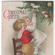 Artist Signed Clapsaddle Boy Helping Girl Reach Ornament Christmas Vintage Postcard