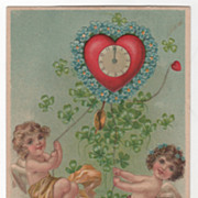 Two Cupids Under Heart-Shaped Clock Valentine's Day Vintage Postcard