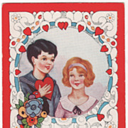 Boy Holding Heart to Chest with Pretty Girl at Side Valentine Vintage Postcard