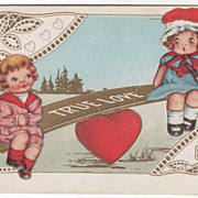 Heart-Based Seesaw with Boy and Girl on It Valentine Vintage Postcard