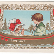 Girl with Bonnet on with Boy in a Canoe Valentine Vintage Postcard