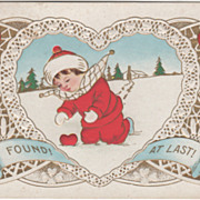 Child Finding Red Heart Buried in the Snow Valentine Vintage Postcard