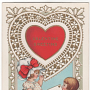 Boy Kneeling to Give Girl a Valentine Valentine Vintage Postcard