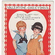 Boy and Girl Set Against a White Heart Valentine Vintage Postcard