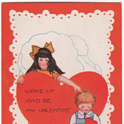 A Girl Waking a Boy Seated at the Base of a Large Red Heart Valentine Vintage Postcard