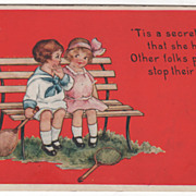 Boy and Girl with Tennis Racquets on a Park Bench Valentine Vintage Postcard