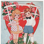 Boy and Girl Holding Heart under an Arbor Valentine Vintage Postcard