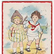 Boy and Girl Walking on a Beach Valentine Vintage Postcard