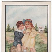 Boy Sitting on a Rock with Arm around Girl Valentine Vintage Postcard