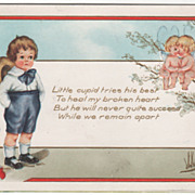 Forlorn Little Boy with Three Cupids Two in a Tree Valentine Vintage Postcard
