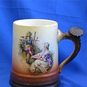 Brown and White Pottery Mug with Courting Couple Twig Handle