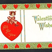 Valentine Postcard of a Little Girl Sitting on a Large Red Heart