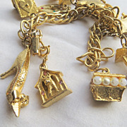 SOLD Vintage luxury chunky gold-tone charm bracelet bird houses wishing wells and more