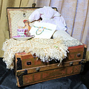 Antique 1869 dome top doll trunk complete with tray and with doll accessories
