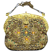 Antique jeweled gold-bullion purse with ornate frame baskets and cherubs