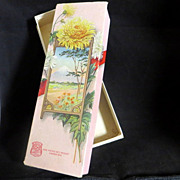 Vintage chocolate candy box beautiful yellow mums flowers and volcano