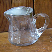 Small Etched Glass Cream Pitcher with Etched Flowers and Flip Up Top