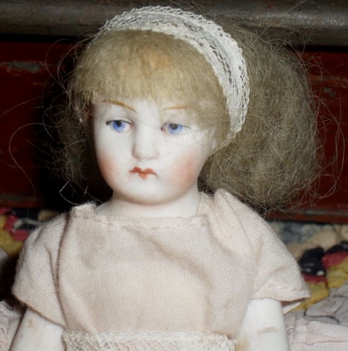 German All Bisque Doll with Pink Shoes