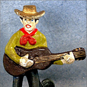 Cast Iron Western Cowboy and Guitar Bottle Opener