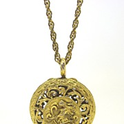Art Nouveau Gold Plated Openwork coin carrier locket on chain