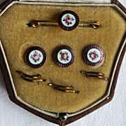 an eAn enamel collar pin and three buttons with spirals in original box
