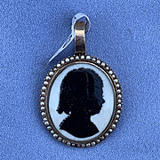 Silhouette of a Young Girl With Natural Pearl Surround