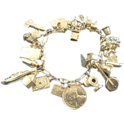 Vintage charm bracelet 26 charms sterling silver