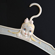 SOLD c1930-40s Child Clothes Hanger with Raised Graphics