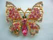 Sparkling butterfly brooch with pink & blue rhinestones