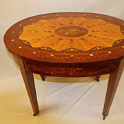 Edwardian Mahogany and Satinwood Oval Sunburst Inlaid Center Table Circa 19th C.
