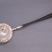 SOLD 1899 -  Sterling Silver Tea Strainer with Ebony Handle