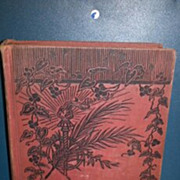 Treasure Island R. L. Stevenson hardback book. No dust cover. Red cover with black vine motif.