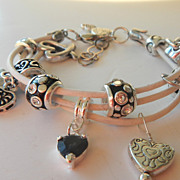 Hearts Motif Charm Bracelet in White Leather