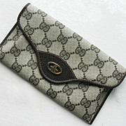 GUCCI Brown Monogram Clutch Wallet