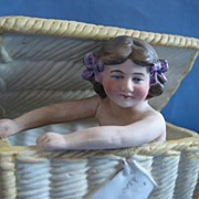 Early German Bisque Fairing Box Young Woman Sitting In Wicker Hamper Ca 1900s