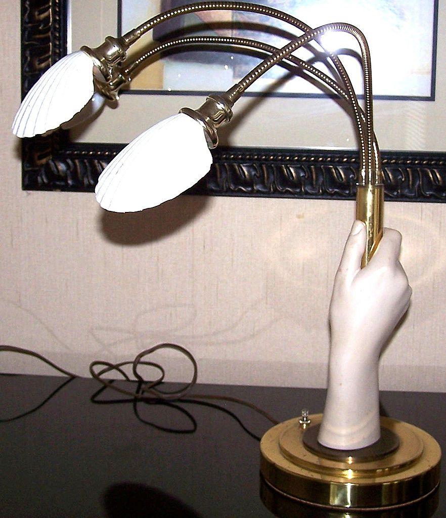 adjustable three arm shell goldtone lamp on hand sculpture. Black Bedroom Furniture Sets. Home Design Ideas