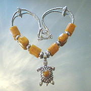 Tibetan Repousse Resin Turtle and Honey Jade Necklace