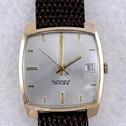 SOLD Quality 18K Calendar Swiss Men�s Wristwatch