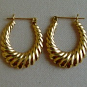 14 Karat Gold Reversible Oval Hoop Pierced Earrings