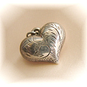 Very puffy vintage unmarked silver heart charm