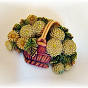 Outstanding vintage mid century celluloid basket of flowers pin tinted