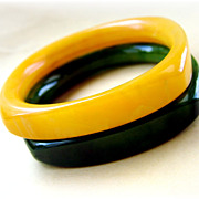 pair of vintage Pair  vintage bakelite bangle bracelets yellow and green rounded square shape