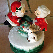 "Music box figures Santa and Mrs Claus on teeter totter tune"" I Saw Mommy Kissing ..."